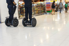 Inspect. Airport police drive segway inspect in the airport Stock Photos