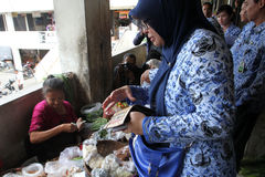 Inspect food. Health officials inspect food sold in markets in the city of Solo, Central Java, Indonesia Royalty Free Stock Photography