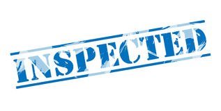 Inspected blue stamp Royalty Free Stock Photo
