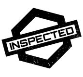 Inspected rubber stamp Stock Photography