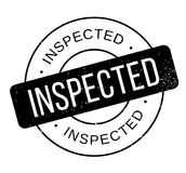 Inspected rubber stamp Stock Photos
