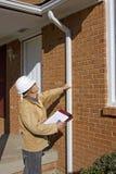 Inspecteur à la maison Image stock