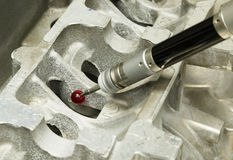 Inspecting aluminium part by CMM. Inspection part by CMM at inspection line Royalty Free Stock Photography