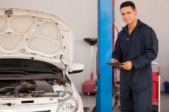 Inspecting a car in an auto shop Stock Photos