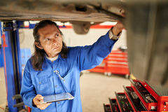 Inspecting car Stock Photo