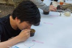 Inspecting coffee sample Stock Image