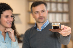 Inspecting cup coffee Stock Image