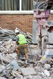 Inspecting Demolition Work. A man inspects a demolition site stock photography