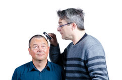 Inspecting his hair Stock Images