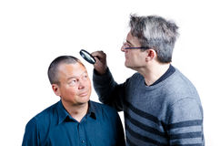 Inspecting his hair Stock Image