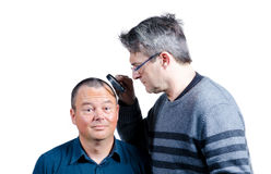 Inspecting his hair Stock Photography