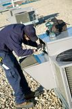 Inspecting roof top unit Stock Photos