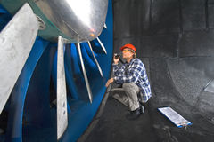 Inspecting a windtunnel Royalty Free Stock Photo