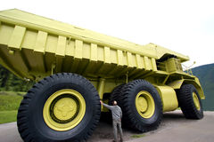 Inspection. Mechanic visualy inspecting a dumptruck Royalty Free Stock Images