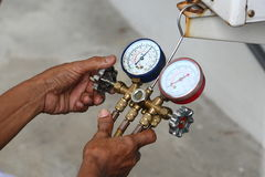 Inspection. Technician inspection refrigerant pressure of airconditioner Royalty Free Stock Image