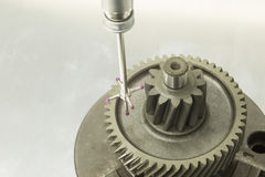 Inspection automotive gear dimension. By CMM measuring machine Stock Photo