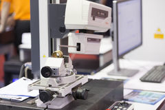 Inspection automotive part by contour measuring machine Stock Photography