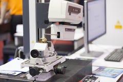 Inspection automotive part by contour measuring machine Stock Photography