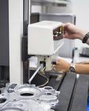 Inspection automotive part by contour measuring machine Stock Photos