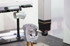 Inspection automotive part dimension. By CMM measuring machine Royalty Free Stock Photos