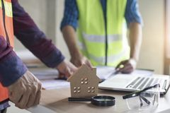 Inspection building concept, Inspector or engineer checking house construction by use magnifying glass on home model royalty free stock photo