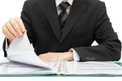 Inspection. Businessman reading binder with accounts Stock Image