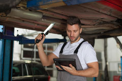 Inspection of a car chassis Stock Photos