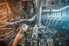 Inspection of a gas turbine engine using a Video Endoscope. Search for defects inside the turbine and shooting on video, photos stock photos