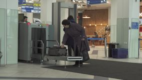 Inspection of luggage and passengers at the entrance to the International Novosibirsk Tolmachevo Airport stock footage stock video