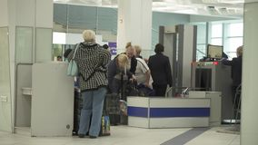 Inspection of luggage and passengers at the entrance to the International Novosibirsk Tolmachevo Airport stock footage stock footage