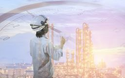 Inspection man concept. In oil refinery industrial on sky sunset Stock Image