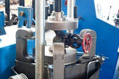 Inspection of pipeline valves, valves on a large metal automatic press in the production plant. Concept industry, work at the plan. T, depreciation of production stock photography