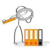 Inspection of records. Stick figure looking through magnifying glass Royalty Free Stock Photography