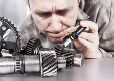 Engineer examine transmission gear parts. Royalty Free Stock Images