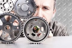 Engineer examine transmission gear parts. Royalty Free Stock Photography