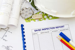 Inspection report. Abstract with engineering tools and hard hat Stock Image