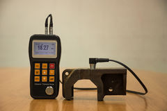 Inspection thickness cast iron by ultrasonic thickness test for. Found internal defect. UTM Stock Image
