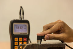 Inspection thickness cast iron by ultrasonic thickness test for. Found internal defect. UTM Stock Photo