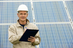 Inspection Visit At Solar Power Station. Technician making inspection at solar power station royalty free stock photos
