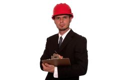 The inspector. Architect inspecting a building, isolated Stock Photos
