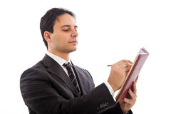Inspector. Serious male inspector / attorney in formal dress taking notes. Isolated against white background Stock Photos