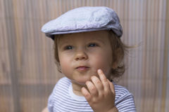 The inspector. Inspector baby boy is wearing his french cap Royalty Free Stock Images