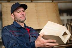 Inspector carpenter inspecting wood furniture part stock photos