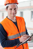 Inspector with clipboard at building site Royalty Free Stock Photography