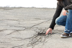 Inspector controlling road damage with potholes based on frost a. Male inspector controlling road damage with potholes based on frost and winter Stock Images