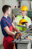 Inspector controlling safety during work at factory Royalty Free Stock Images