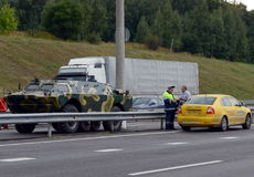 The inspector dorozhno-patrol service checks the documents of a taxi driver on the highway `Don`. MOSCOW REGION, RUSSIA - AUGUST 27,2014:The inspector dorozhno Royalty Free Stock Photo