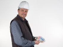 Inspector with helmet and lot of money Stock Photos