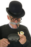 Inspector with magnifier Stock Photos