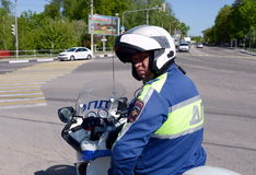 The inspector of motorized units road policing controls the highway. Royalty Free Stock Photos